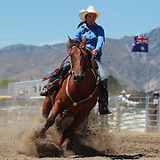 Tineka McDonald from Darfield in action during the Open Barrel Race at the Wanaka Rodeo. Wanaka, South Island, New Zealand. 2nd January 2012