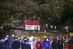 August 17, 2017 - Yogyakarta, Indonesia - Indonesian citizens salute an Indonesian flag during a ceremony marking Indonesia's 72nd Independence Day inside the Jlamprong Cave in Yogyakarta, Indonesia on August 17, 2017. (Credit Image: © Reza Fitriyanto/NurPhoto via ZUMA Press)