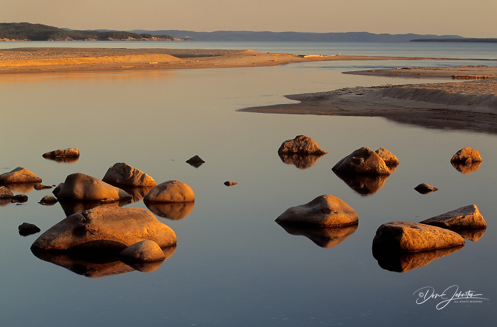 Evening light on boulders at the mouth of the Sand River, Lake Superior Provincial Park, Ontario, Canada