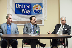 Mark Primeau, right, discusses the changes coming with the merger of Lakes Region United Way and Granite United Way during a press conference on Tuesday, January 22, 2013.  On the left are Jack Terrell and Patrick Tufts.  (Alan MacRae/for the Laconia Daily Sun)