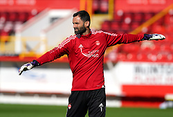 Aberdeen goalkeeper Joe Lewis warming up prior to kick-off during the cinch Premiership match at Pittodrie Stadium, Aberdeen. Picture date: Sunday October 3, 2021.