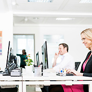 A team of co workers enjoying each other company in a bright, modern office. Photographed for Regus by commercial and advertising photographer Stuart Freeman.