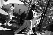 ORG XMIT: *S0423416317* (04/18/2008) -- Juan, left, engages in a fight after being approached aggressively by alternative school classmates from Village Fair after school at the DART Zoo station Friday April 18, 2008.