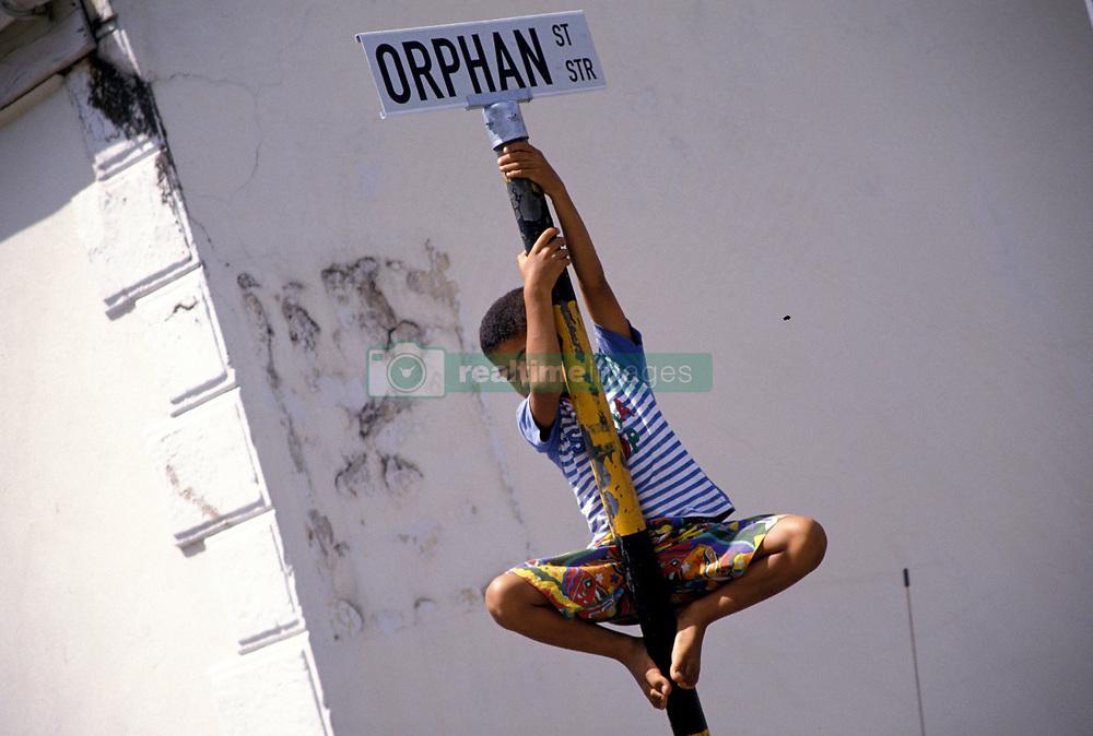 Boy climbing road sign (Credit Image: © Axiom/ZUMApress.com)