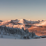 A merge of 5 separate image displays the full range of the Wasatch Back, including the newly protected Bonanza Flats area on the right. Full moon at sunrise.