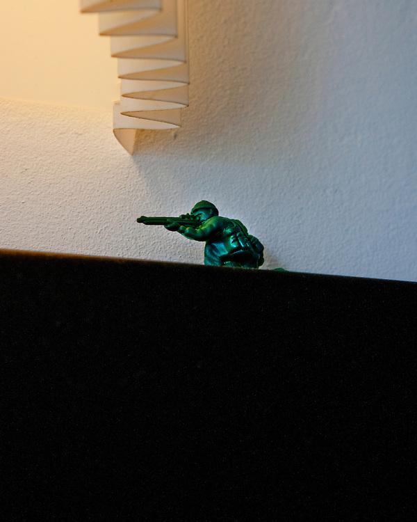 Toy Green Soldier pointing a gun