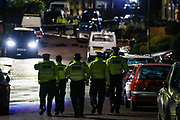 A new shift of police officers arrive at a crime scene in the Dale Close Road, in Barnet, North London on late Wednesday, Sept 23, 2020, after several police officers have been injured by a chemical substance while carrying out a drugs raid in north London. (VXP Photo/ Vudi Xhymshiti)