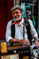 French street musician, Rue Cler street market, Paris, France.