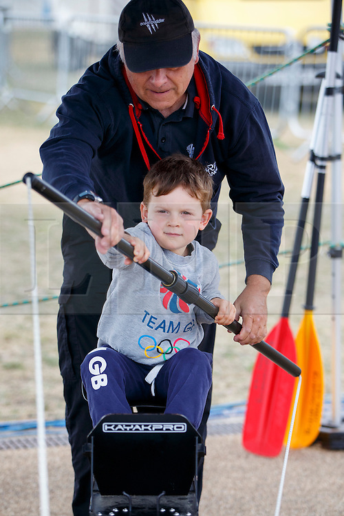 © Licensed to London News Pictures. 03/09/2016. LONDON, UK. George Brant tries paralympic rowing to experience the disability sports at National Paralympic Day and Liberty Festival in Queen Elizabeth Olympic Park in London on Saturday 3 Spetember 2016. Photo credit : Tolga Akmen/LNP