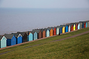 Colourful beach huts along the coast near to Whitstable on the way to Hearne Bay.