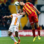 Kayserispor's Ceyhun Gulselam (R) and Galatasaray's Tebily Didier Yves Drogba (L) during their Turkish superleague soccer match Kayserispor between Galatasaray at Kadir Has Stadium in Kayseri Turkey on Sunday, 17 March 2013. Photo by TURKPIX
