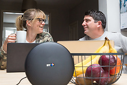 Mum Nancy, 43 and Dad Chris, 44, are able to manage their whole family's online demands thanks to BT Wifi. Real-life case study campaign, showcasing BT's complete Wi-Fi offering. London, May 16 2019.