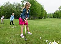Taking a practice swing during golf lessons at Bolduc Park.  (Karen Bobotas Photographer)