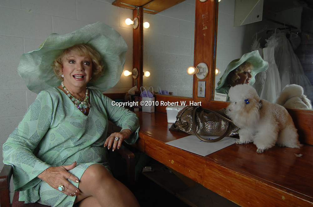 """Actress Ruta Lee will reprise her role as Miss Mona in the upcoming production of """"The Best Little Whorehous in Texas"""" at Casa Mañana Theater in Fort Worth, Texas. Photo taken on October 6, 2010. Her dog, Kissy, is at right. (Credit: Robert W. Hart)"""