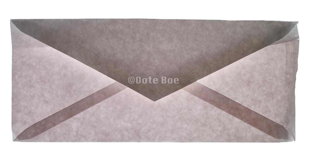 back view of a slightly damaged blank correspondence letter envelope