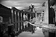 The Canopus, an elongated canal imitating the famous sanctuary of Serapis near Alexandria. The semi-circular exedra of the Serapeum is located at its southern end, dedicated to the gods Isis and Serpis which was probably used as a banqueting hall. Hadrian's Villa ( Villa Adriana ) built during the second and third decades of the 2nd century AD, Tivoli, Italy. A UNESCO World Heritage Site. .<br /> <br /> If you prefer to buy from our ALAMY PHOTO LIBRARY  Collection visit : https://www.alamy.com/portfolio/paul-williams-funkystock/hadrians-villa-tivoli.html<br /> Visit our CLASSICAL WORLD HISTORIC SITES PHOTO COLLECTIONS for more photos to buy as buy as wall art prints https://funkystock.photoshelter.com/gallery-collection/Classical-Era-Historic-Sites-Archaeological-Sites-Pictures-Images/C0000g4bSGiDL9rw