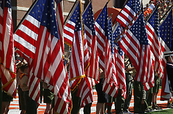 American Flag presentation before a football game.  Colors are presented by several Boy Scouts