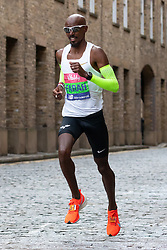 © Licensed to London News Pictures. 10/03/2019. London, UK.  Britain's Mo Farah running through Wapping on cobbled streets at the six mile point during The Big Half Marathon 2019.  Photo credit: Vickie Flores/LNP