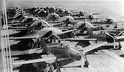 Aircraft are prepared for a morning sortie on the Imperial Japanese Navy aircraft carrier Zuikaku, east of the Solomon Islands, on May 5, 1942. On May 7 and 8 the carrier was involved in exchanges of airstrikes with United States Navy carriers during the Battle of the Coral Sea.
