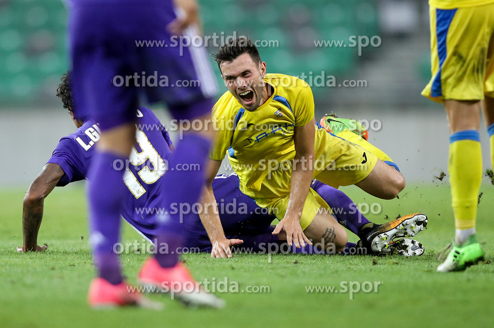 Luiz Gustavo of Olympic Marseille and Amedej Vetrih of NK Domzale during football match between NK Domzale and Olympique de Marseille in First game of UEFA Europa League playoff round, on August 17, 2017 in SRC Stozice, Ljubljana, Slovenia. Photo by Morgan Kristan / Sportida