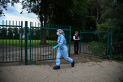 © Licensed to London News Pictures. 24/08/2020. London, UK. A forensic officer outside St James Park, Walthamstow, East London as detectives launch an investigating following the discovery of a man's body. Police were called by a member of the public at approximately 13:40hrs to St James Park, E17, after a person was found unresponsive. A man, aged in his thirties, was pronounced dead at the scene. Photo credit: Dinendra Haria/LNP