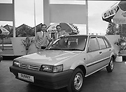 "Nissan Launches New ""Sunny""..1986..21.08.1986..08.21.1986..21st August 1986..Nissan Ireland launched the all new integrated Sunny range on to the Irish market.The launch was the European premiere of this model and marked a significant second phase in the rationalisation of the Nissan Product range. The first Phase was the launch of the Bluebird range in February of this year. The Launch took place at Nissan House, Naas Road Dublin...Image shows Mr Tony Kelly,Deputy Managing Director,Nissan,Ireland (right) and Mr Gerard O'Toole,Managing Director,Nissan Ireland at the ""Sunny"" launch."