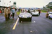 Whitsun Sports car race 3 June 1963, John Coundley in Jaguar D-type car on start line, Goodwood, England, UK Pat Coundley standing