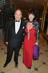 OLIVER DE ROTHSCHILD and KAREN MANN at 'A Night of Champions' an evening to raise funds for the Mo Farah Foundation held at The Hurlingham Club, London on 28th August 2014.