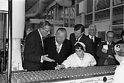 17/04/1963<br /> 04/17/1963<br /> 17 April 1963<br /> Lord Mayor of Birmingham visits Fry-Cadbury factory, Colock, Malahide Road, Dublin. Image shows (l-r): Arthur Lyle, Joint Managing Director explaining part of the manufacturing process to the Lord Mayor of Dublin, J.J. O'Keeffe; Raymond Sellers, Joint Managing Director and Mr. V.M. Woods.