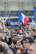 """Protesters hold crayons and pens aloft to signal support for Charlie Hebdo and Freedom of Press during the massive public rally """"Cry for Freedom"""" takes place in central Paris on Sunday afternoon. The rally brought in people of all colors and creeds from both France and abroad. Many were carrying placards with various slogans. This demonstration happened the weekend after armed gunmen attacked the offices of Charlie Hebdo, killing twelve people, including the editor and celebrated cartoonists; four more are in critical condition. It is the dealiest terror attack in France for over fifty years. Charlie Hebdo is a satirical publication well known for its political cartoons. The jihadists responsible were killed by police in several shootouts on the Friday afternoon.  <br /><br />As a solidarity actions with the deaths at Charlie Hebdo many placards read """"Je suis Charlie"""" translating as """"I am Charlie (Hebdo)"""". Demonstrators held aloft pens, brushes and crayons, symbolizing the profession of journalists and cartoonists who were killed. Many pens were placed in a shrine with candles in the square. Some protesters also refused to ally themselves with Charlie Hebdo."""