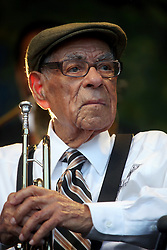 05 May 2012. New Orleans, Louisiana,  USA. .New Orleans Jazz and Heritage Festival. .100 year old jazz trumpeter Lionel Ferbos performs with the 'Preservation Hall and Friends' ensemble. .Photo; Charlie Varley.
