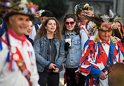 """© Licensed to London News Pictures. 01/05/2018. Oxford, UK. Members of the public watch Morris dancers in dress  dance next to Hertford Bridge, often called """"the Bridge of Sighs"""" in Oxford, Oxfordshire as part of May Day celebrations. Students were again prevented from jumping from Magdalen Bridge in to the river, which has historically been a tradition, due to injuries at a previous years event . Photo credit: Ben Cawthra/LNP"""