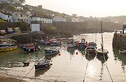 Small fishing boats moored in the harbour, Coverack, Cornwall, England, UK