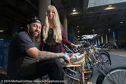"""Hanna and Ryan Grossman with Ryan's  1948 HD Panhead known as Dean """"The Dean"""" Lanza's Quicksilver dual-carbed Panhead """"Show Dragster"""" at the local docks before the Mooneyes Yokohama Hot Rod & Custom Show. Yokohama, Japan. December 6, 2015.  Photography ©2015 Michael Lichter."""