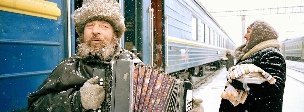 Accordian player along the Trans Siberian Railway, Siberia, Russia
