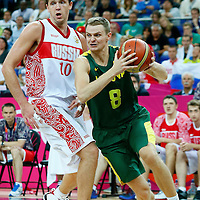 08 August 2012: Lithuania Renaldas Seibutis drives past Russia Russia  Victor Khryapa during Team Russia vs Team Lithuania, during the men's basketball quarter-finals, at the 02 Arena, in London, Great Britain.