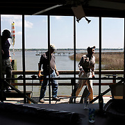 From left, Bill Kennedy, of Beaufort, Steve Parker, of Beaufort, and Jimmy Wiggins, of Beaufort, perform some maintenance of the slats after replacing the screens yesterday on their dock off of Hancock Street in The Point neighborhood on April 23, 2014.