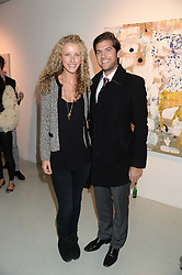 JACK & KATE FREUD at a private view of an exhibition of paintings by Billy Zane entitled 'Save The Day Bed' held at the Rook & Raven Gallery, Rathbone Place, London on 10th October 2013.