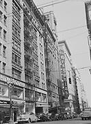 Y-470900-1. SW Alder looking east to Broadway. Old Oregonian building. September 1947.