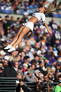 A Baltimore Ravens cheerleader flies in the air as she performs a leaping dance routine during the NFL week 13 regular season football game against the San Diego Chargers on Sunday, Nov. 30, 2014 in Baltimore. The Chargers won the game 34-33. ©Paul Anthony Spinelli