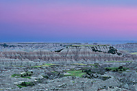 After the sun went down over the Badlands, the sky turned a deep pink color. A thunderstorm rolled in as the buttes reflected the color of the sky.