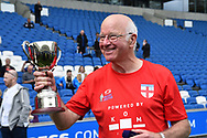 Tommy Charlton of England over 60's with the Just International Cup winners trophy at full time during the world's first Walking Football International match between England and Italy at the American Express Community Stadium, Brighton and Hove, England on 13 May 2018. Picture by Graham Hunt.