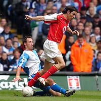 Photo. Daniel Hambury, Digitalsport<br /> Arsenal v Blackburn Rovers. <br /> FA Cup Semi Final.<br /> 16/04/2005.<br /> Arsenal's Robert Pires is tackled by Blackburn Rovers' Lucas Neill
