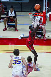 NORMAL, IL - February 27: Abdou Ndiaye goes to the hoop for an assumed 2 points, but the bucket is rescinded due to an offensive foul for knocking down defender Bowen Born during a college basketball game between the ISU Redbirds and the Northern Iowa Panthers on February 27 2021 at Redbird Arena in Normal, IL. (Photo by Alan Look)