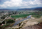 CS00779-11. View from Ochoco Wayside State Park along the rimrock overlooking Prineville, Oregon, looking east. 1956