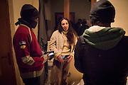 November 7, 2016,  Breil-sur-Roya, French Alpes, France. Éloïse shows two Eritrean migrants where they can sleep in her house.   She picked up the 5 refugees when they walked on the road, and will shelter them in her home for one night. She is married, a mother of 2 young children,  and does not hesitate to welcome migrants in her farm house.<br /> <br /> 7 novembre 2016, Breil-sur-Roya, Alpes françaises, France. Éloïse montre à deux migrants érythréens où ils peuvent dormir dans sa maison. Elle a trouvé 5 réfugiés sur la route, et les héberge dans sa maison pour une nuit. Elle est mariée, mère de 2 jeunes enfants, et n'hésite pas à accueillir des migrants chez elle.