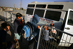 Students board an armored school bus at the Newe Deqalim settlement, Gaza, Palestinian Territories, Nov. 6, 2004. This particular settlement gets mortared regularly. Israel's parliament recently supported compensation payments for Jewish settlers leaving the Gaza Strip, in a vital vote for Prime Minister Ariel Sharon's plan to evacuate the occupied territory.