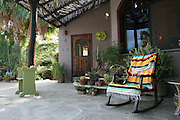 Rocking chair with colorful Mexican blanket to relax and enjoy your sunny days in the East Cape of Baja California Sur. <br /> Photo is part of set of photographs of a beach front home in Los Barriles, Baja California Sur, Mexico.