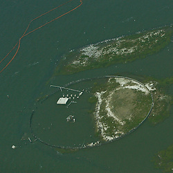A double layer of oil containment boom is laid out in an effort to protect the Breton National Wildlife Refuge off the coast of Louisiana in the Gulf of Mexico, U.S., on Saturday, May 1, 2010. The BP Plc Deepwater Horizon drilling rig oil spill is threatening the wildlife that inhabit Breton Sound including the Louisiana state bird the brown pelican. Photographer: Derick E. Hingle.