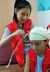 August 28, 2017 - Suzhou, Suzhou, China - Suzhou, CHINA-28th August 2017: (EDITORIAL USE ONLY. CHINA OUT) ..Kids learn emergency nursing skills in Suzhou, east China's Jiangsu Province, August 28th, 2017. (Credit Image: © SIPA Asia via ZUMA Wire)